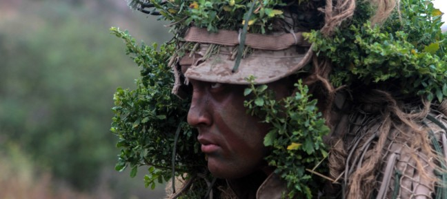 An US marine in stalking attentively (Danielle Rodrigues/USMC)