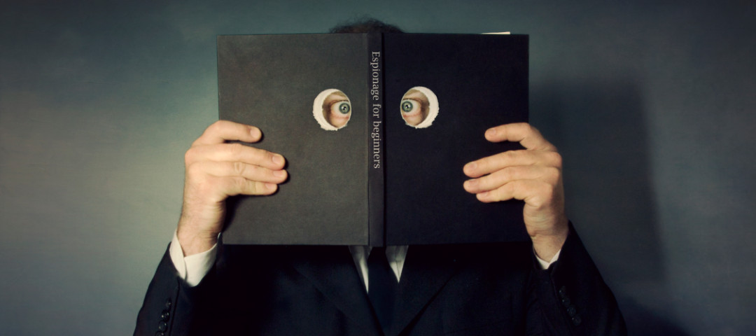 A man who is spying through a book (Scott MacBride/Getty Images)